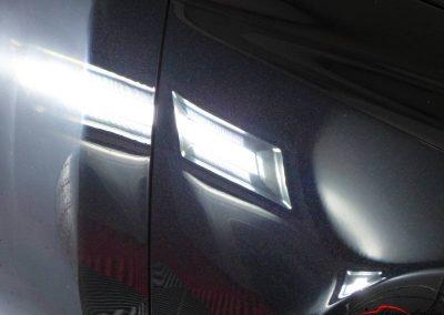 reflet éclairage dans la carrosserie Audi RS5 Evry
